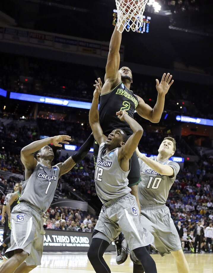 Baylor's Rico Gathers (02) shoots over Creighton's Austin Chatman (01), Creighton's Jahenns Manigat (12), and Creighton's Grant Gibbs (10) during first half action of their third round 2014 NCAA Division I Men's Basketball Championship tournament game held Sunday March 23, 2014 at the AT&T Center. Photo: Edward A. Ornelas, San Antonio Express-News