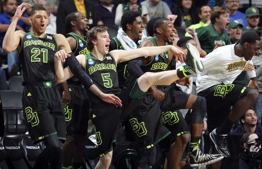 Members of the Baylor Bears react after a score late in their third round 2014 NCAA Division I Men's Basketball Championship tournament game against Creighton Sunday March 23, 2014 at the AT&T Center. Baylor won 85-55. Photo: Edward A. Ornelas, San Antonio Express-News