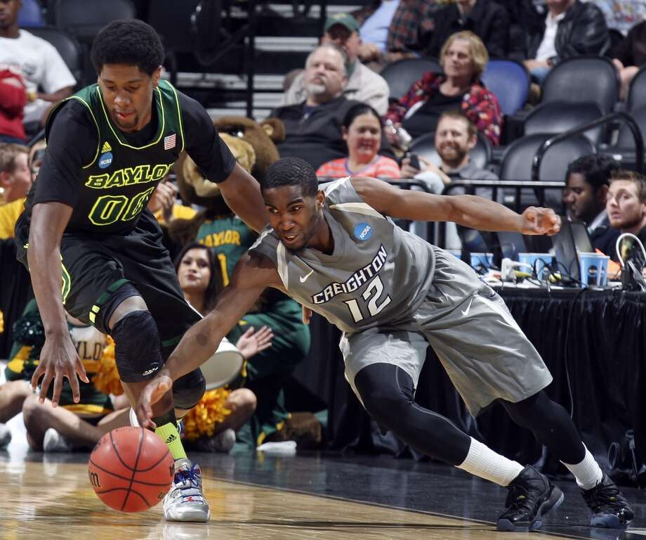 Baylor's Royce O'Neale (00) and Creighton's Jahenns Manigat (12) grab for a loose ball during second half action of their third round 2014 NCAA Division I Men's Basketball Championship tournament game held Sunday March 23, 2014 at the AT&T Center. Baylor won 85-55. Photo: Edward A. Ornelas, San Antonio Express-News