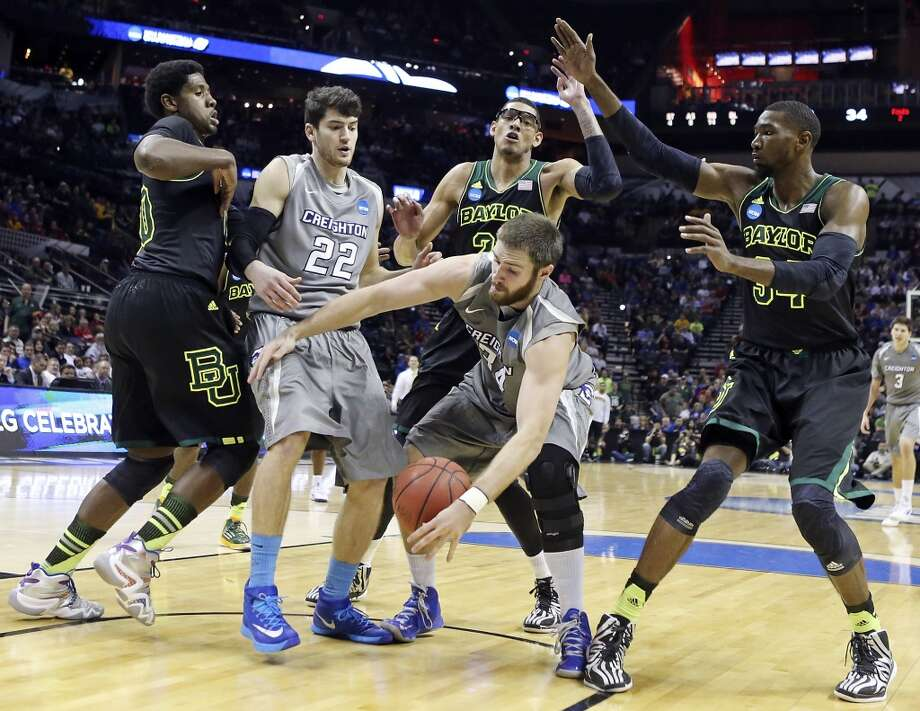 Baylor's Royce O'Neale (00) ,from left, Creighton's Avery Dingman (22), Baylor's Isaiah Austin (21), Creighton's Ethan Wragge (34) and Baylor's Cory Jefferson (34) chase after a loose ball during second half action of their third round 2014 NCAA Division I Men's Basketball Championship tournament game held Sunday March 23, 2014 at the AT&T Center. Baylor won 85-55. Photo: Edward A. Ornelas, San Antonio Express-News
