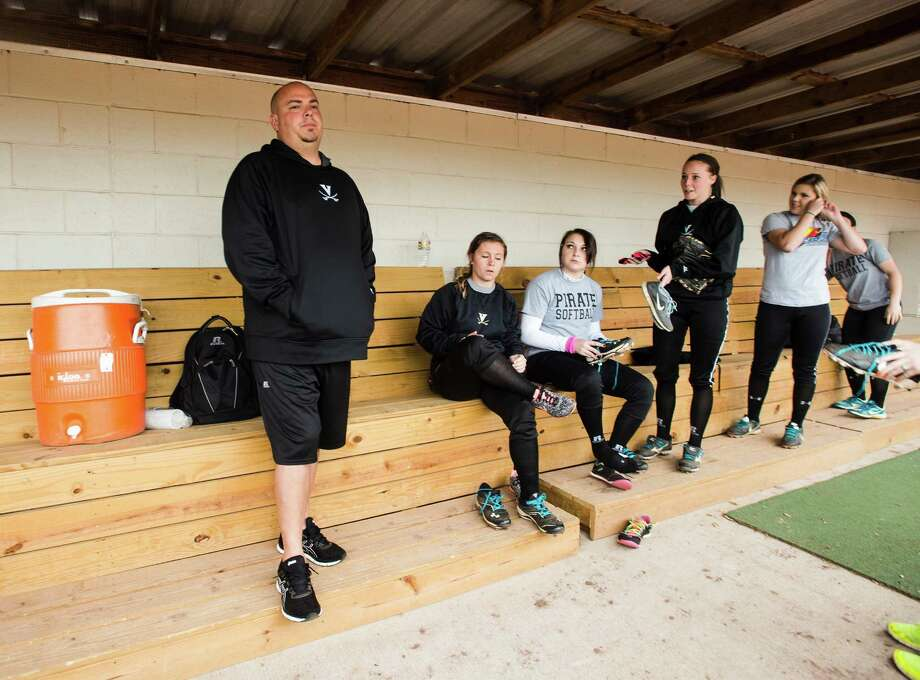 Coach Darin Fletcher stands in a dugout with Vidor softball players before practice Wednesady. The Vidor High School softball team practiced Wednesday afternoon before rain drove them off the field. Photo taken Wednesday, 3/26/14 Jake Daniels/@JakeD_in_SETX Photo: Jake Daniels / ©2014 The Beaumont Enterprise/Jake Daniels