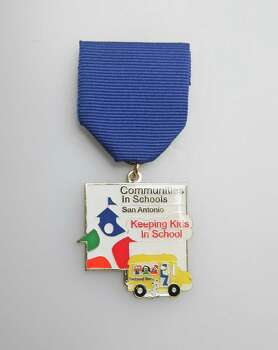 The Friends of Communities in Schools of San Antonio's Fiesta medal honors its annual Stuff the Bush initiative that provides supplies for at-risk students. The medal will be traded at a not-for-profit Fiesta Medal swap meet and given to teachers in the Title I schools in which Communities in Schools of San Antonio is represented, www.cissa.org/get-involved/friends-of-cis-sa. Photo: Juanito M. Garza, San Antonio Express-News / San Antonio Express-News