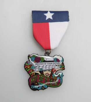 "Institute of Texan Cultures' ""Hats Off to Fiesta!"" medal, which points to its March 28-July 6 exhibition of the same name showcasing about 50 Fiesta hats, 2014 Fiesta medals and NIOSA in pictures, $7, at the Fiesta Store and the ITC Store, www.TexanCultures.com. Photo: Juanito M. Garza, San Antonio Express-News / San Antonio Express-News"