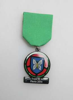 St. Mark's Episcopal Church's Fiesta medal commemorates its stained glass windows each year, $8, at the Fiesta Store and the church, 315 E. Pecan St., www.stmarks-sa.org. Photo: Juanito M. Garza, San Antonio Express-News / San Antonio Express-News
