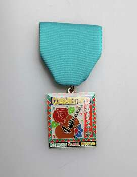 Northside School Museum Association 2014 Fiesta medal, $5, available at the Northside Education Foundation Partnerships Office, 6632 Bandera Road, (210) 397-8599. Photo: Juanito M. Garza, San Antonio Express-News / San Antonio Express-News