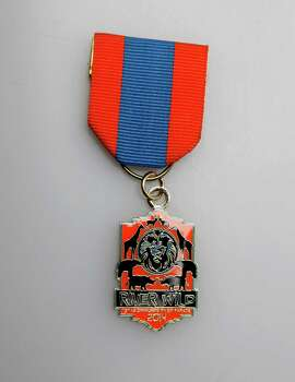 Texas Cavaliers' River Parade medal, $10, at the Fiesta Store, www.texascavaliers.org. Photo: Juanito M. Garza, San Antonio Express-News / San Antonio Express-News
