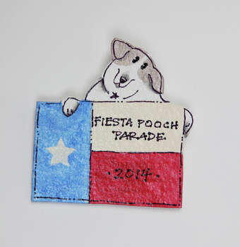 Therapy Animals of San Antonio 2014 Fiesta Medal, $5, at the Fiesta Store. Photo: Juanito M. Garza, San Antonio Express-News / San Antonio Express-News