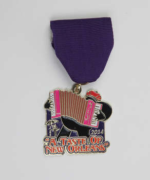 San Antonio Zulu Association's Taste of New Orleans 2014 Fiesta Medal, April 11-13 at the Sunken Gardens, www.saza.org. Photo: Juanito M. Garza, San Antonio Express-News / San Antonio Express-News