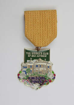 San Antonio Woman's Club Fiesta medal features its historic headquarters, $8, at the Fiesta Store and the club, 1717 San Pedro Ave., www.thewomansclubsa.org. Photo: Juanito M. Garza, San Antonio Express-News / San Antonio Express-News