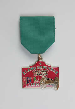 Alamo Defender Gregorio Esparza Fiesta medal commissioned by descendant Peggy Huizar Guerrero, who sells them for $5 or in a medal exchange, email peggysguerrero@gmail.com. Photo: Juanito M Garza, San Antonio Express-News / San Antonio Express-News