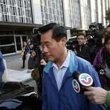Sen. Leland Yee is questioned by reporters as he leaves the federal building in S.F.