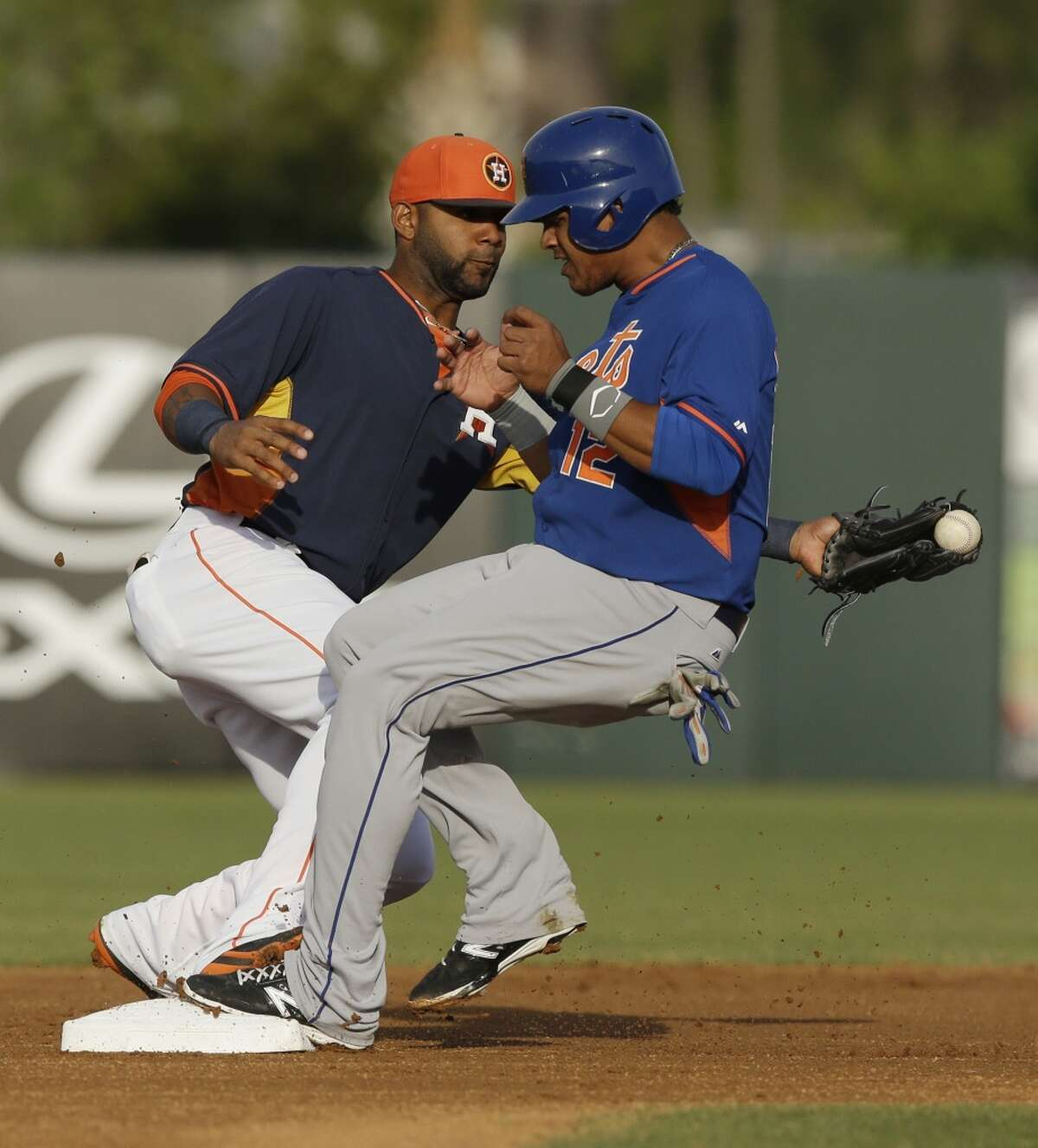 March 26: Astros 9, Mets 6 Juan Lagares beats the throw to shortstop and steals second base.