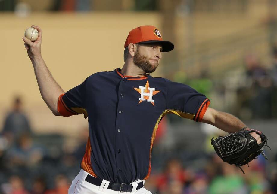 Astros starting pitcher Scott Feldman throws. Photo: Carlos Osorio, Associated Press