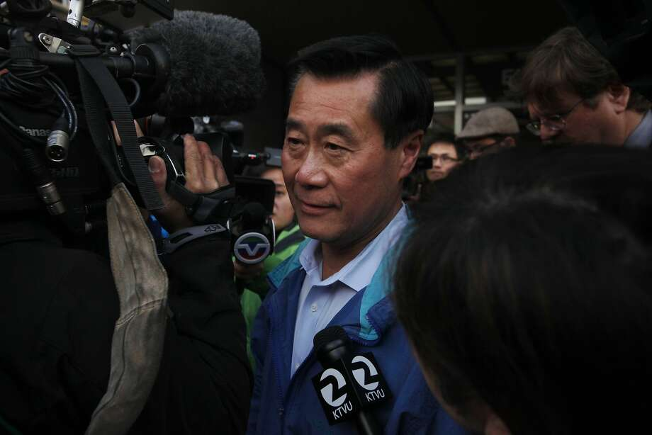 State Sen. Leland Yee makes his way through a large flock of media members to a car after being released on a $500,000 bond March 26, 2014 outside of the Federal Courthouse in San Francisco, Calif. State Sen. Leland Yee was arrested on public corruption charges early Wednesday morning. Photo: Leah Millis, The Chronicle