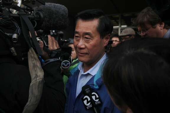 State Sen. Leland Yee makes his way through a large flock of media members to a car after being released on a $500,000 bond March 26, 2014 outside of the Federal Courthouse in San Francisco, Calif. State Sen. Leland Yee was arrested on public corruption charges early Wednesday morning.