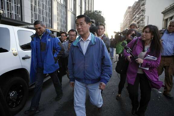 Senator Leland Yee is chased by reporters as he leaves the federal building in San Francisco, CA, Wednesday Mar. 26, 2014.   The FBI raided State Sen. Leland Yee's office in Sacramento and other locations were searched by the FBI in San Francisco. He was reportedly arrested on public corruption charges Wednesday morning amid raids of his office in Sacramento and searches by the FBI in San Francisco.