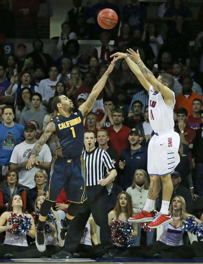 Nic Moore shoots the winning three-pointer over Justin Cobbs, whose own three-pointer had put Cal ahead moments earlier. Photo: Louis DeLuca, McClatchy-Tribune News Service