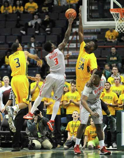Siena's Imoh Silas defends a shot from Illinois State's Daishon Knight during their men's basketball