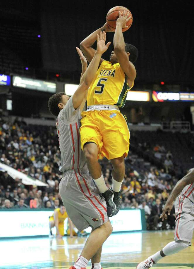 Siena's Evan Hymes goes to the basket during their men's basketball semifinals of the College Basketball Invitational against Illinois State at Times Union Center on Wednesday March 26, 2014 in Albany, N.Y. (Michael P. Farrell/Times Union) Photo: Michael P. Farrell / 00026273A