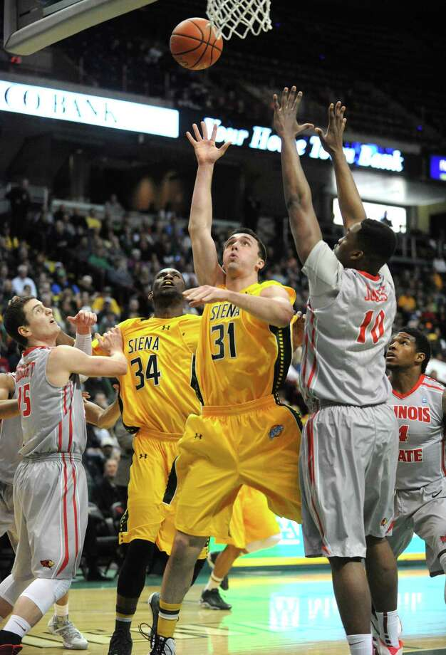 Siena's Brett Bisping goes to the basket during their men's basketball semifinals of the College Basketball Invitational against Illinois State at Times Union Center on Wednesday March 26, 2014 in Albany, N.Y. (Michael P. Farrell/Times Union) Photo: Michael P. Farrell / 00026273A