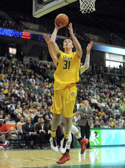 Siena's Brett Bisping goes to the basket during their men's basketball semifinals of the College Bas