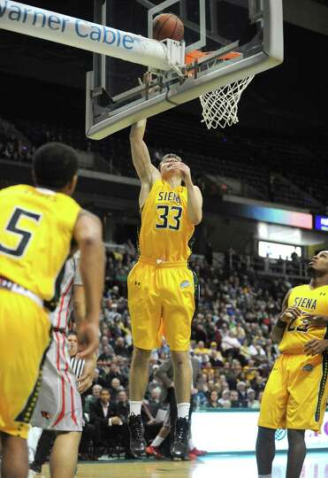 Siena's Rob Poole goes to the basket during their men's basketball semifinals of the College Basketb
