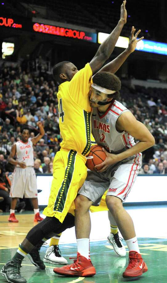 Siena's Imoh Silas defends Illinois State's Reggie Lynch during their men's basketball semifinals of the College Basketball Invitational at Times Union Center on Wednesday March 26, 2014 in Albany, N.Y. (Michael P. Farrell/Times Union) Photo: Michael P. Farrell / 00026273A