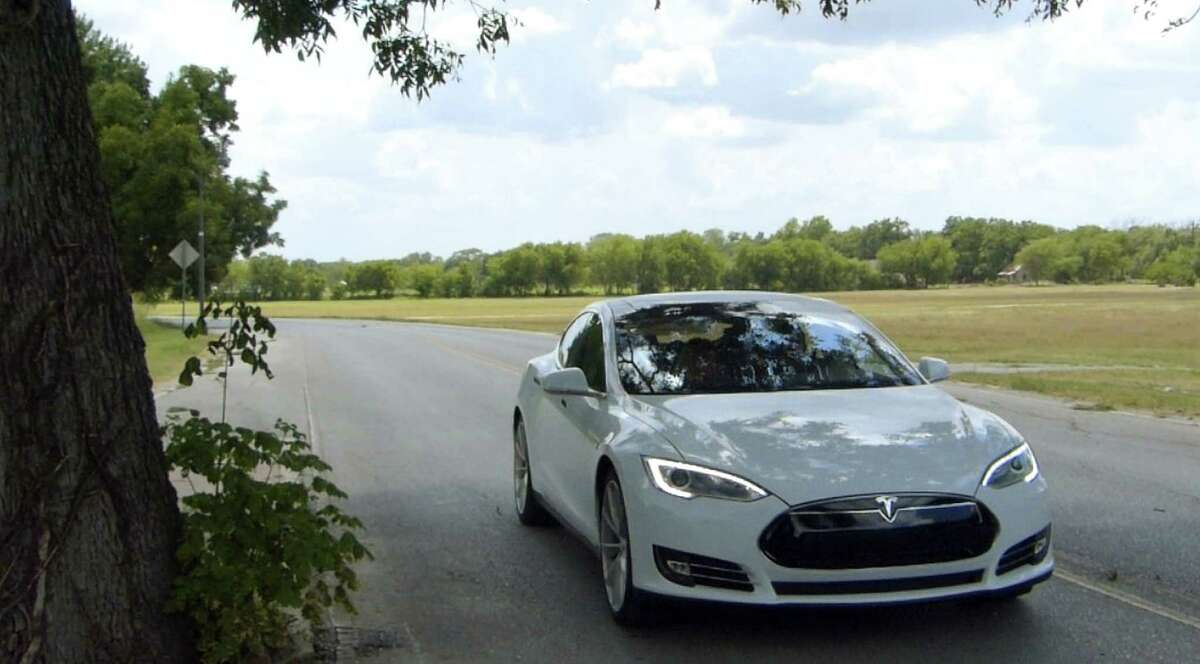 Scenes like this all-electric Tesla Model S sedan making its way along Mission Road could become more common if the company opens a battery plant here.