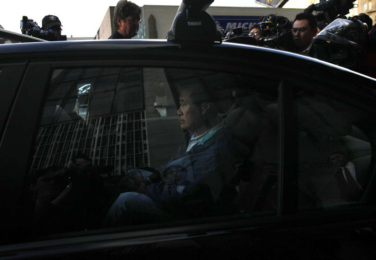 State Sen. Leland Yee pulls away in a car surrounded by media members after being released on a $500,000 bond March 26, 2014 outside of the Federal Courthouse in San Francisco, Calif. State Sen.