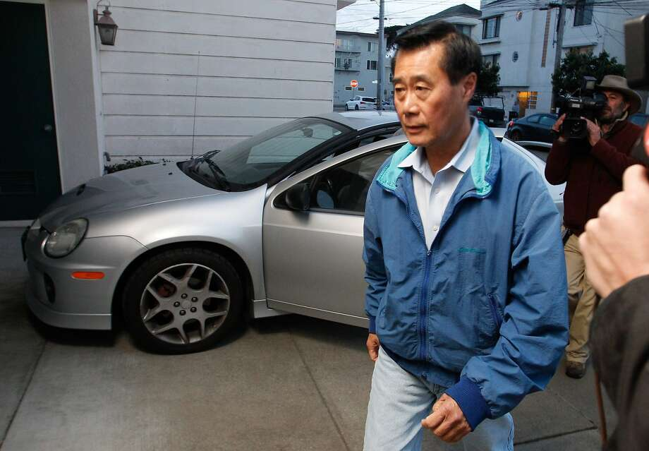 State Sen. Leland Yee (D-San Francisco) arrives at his house in the Sunset District after being charged in federal court in San Francisco on Wednesday, March 26, 2014. Yee was one of 26 people charged after a 5-year racketeering, gun running, narcotics, and money laundering investigation by the FBI. Photo: Mathew Sumner, Special To The Chronicle