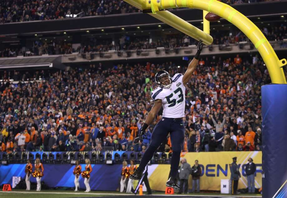 Superbowl MVP Malcolm Smith dunks the ball over the uprights as he scores a touchdown on a interception in the second quarter at Super Bowl XLVIII Sunday, Feb. 2, 2014, at MetLife Stadium in New Jersey. (Joshua Trujillo, seattlepi.com) Photo: SEATTLEPI.COM