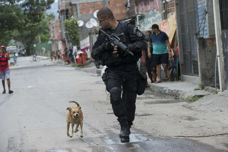 And stay away! A snarling dog chases a Special Police Operations Battalion officer during a 