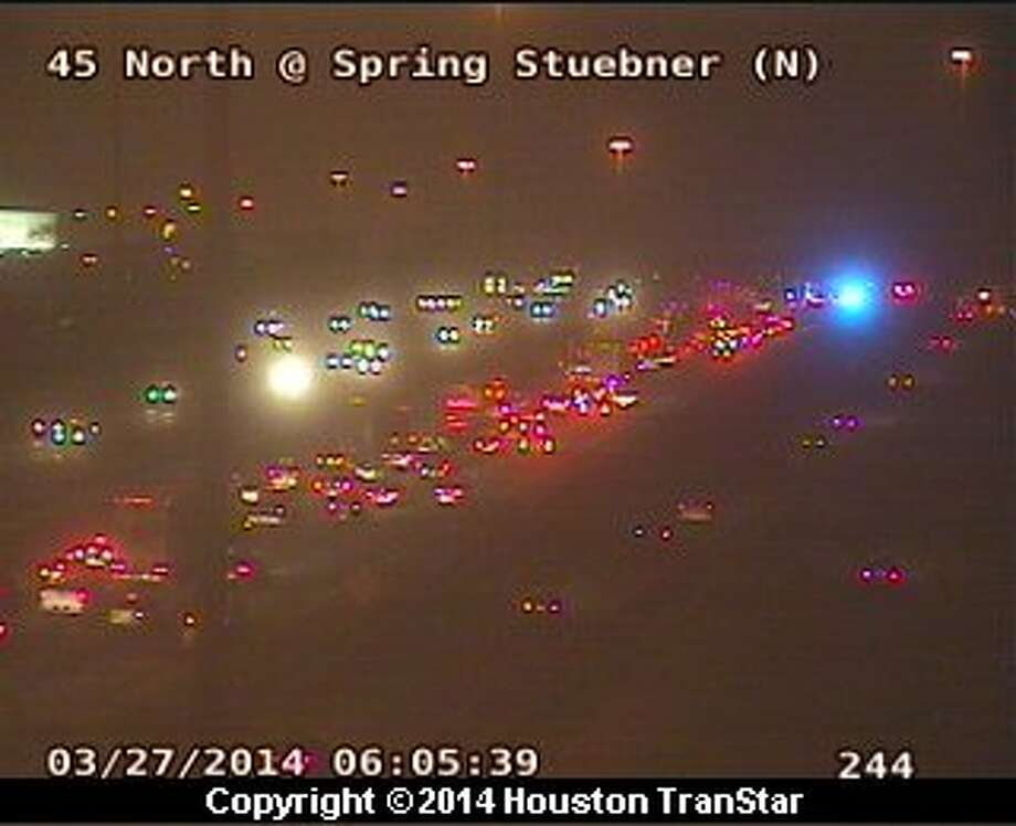Traffic was snarled on inbound North Freeway near Spirng Stuebner after a truck crash and Hazmat spill about 5:20 a.m. Thursday. Photo: Houston Transtar