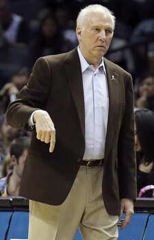 San Antonio Spurs head coach Gregg Popovich call a play during second half action against the Orlando Magic Saturday March 8, 2014 at the AT&T Center. The Spurs won 121-112. Photo: Edward A. Ornelas, San Antonio Express-News