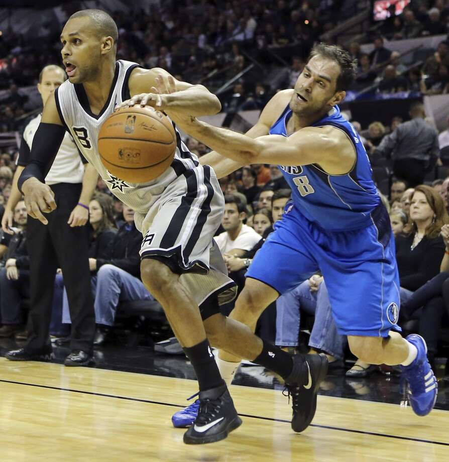 San Antonio Spurs' Patty Mills drives around Dallas Mavericks' Jose Calderon during first half action Sunday March 2, 2014 at the AT&T Center. Photo: Edward A. Ornelas, San Antonio Express-News