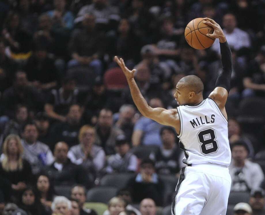 Guard Patty Mills of the San Antonio Spurs looks to pass during second-half NBA action against Detroit in the AT&T Center on Wednesday, Feb. 26, 2014. Photo: Billy Calzada, San Antonio Express-News