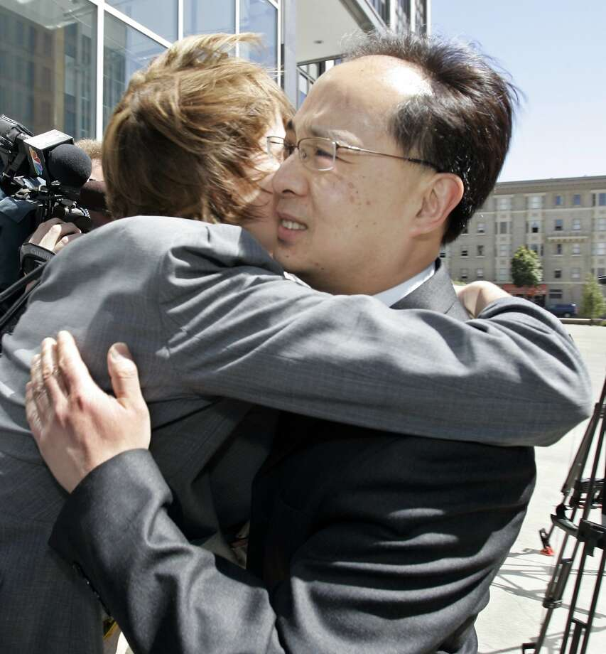 Former San Francisco Supervisor Ed Jew, right, gets a hug from a supporter outside the federal courthouse in San Francisco after being sentencing to five years and four months in prison in 2009. In 2007 Leland Yee brought to the attention of the FBI alligations that Jew had been shaking down tapioca-drink store owners seeking city permits in the Sunset District. Photo: Paul Sakuma, AP