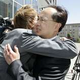 Former San Francisco Supervisor Ed Jew, right, gets a hug from a supporter outside the federal courthouse in San Francisco after being sentencing to five years and four months in prison in 2009. In 2007 Leland Yee brought to the attention of the FBI alligations that Jew had been shaking down tapioca-drink store owners seeking city permits in the Sunset District.