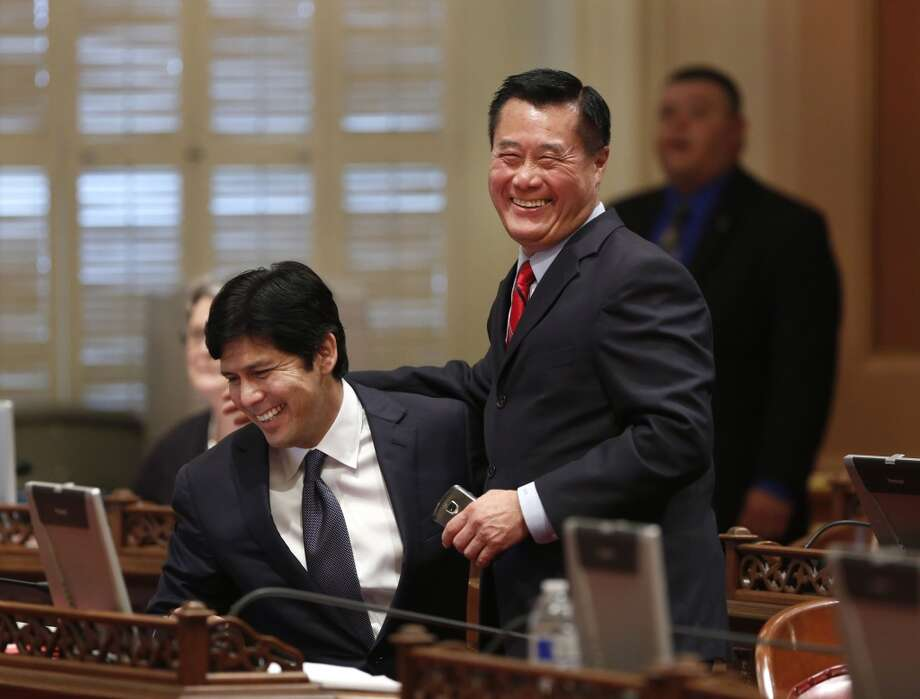 This May 29, 2013, file photo shows State Senator Leland Yee, D-San Francisco, right, and Sen. Kevin de Leon, D-Los Angeles, celebrating the passage of their gun control measures  during the Senate session at the Capitol in Sacramento, Calif. Yee, the 65-year-old San Francisco Democrat was arrested Wednesday March 26, 2014, during a series of raids by the FBI in Sacramento and the San Francisco Bay Area. He was later arraigned on charges that alleged illegal dealing in firearms, wire fraud and trading the influence of his office for money. Photo: Rich Pedroncelli, Associated Press