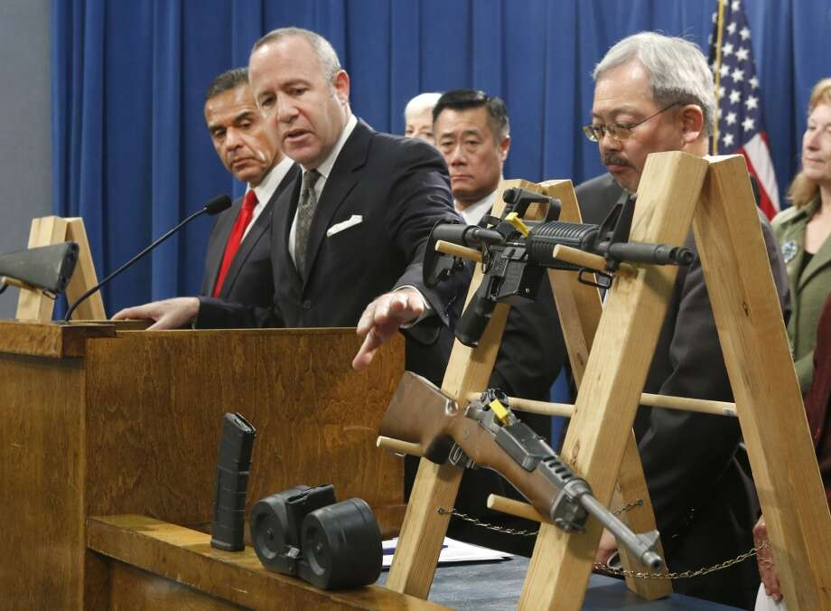 This Feb. 7, 2013 file photo shows Senate President Pro Tem Darrell Steinberg, second from left, looking at a pair of semi-automatic rifles as he discusses gun control legislation at a Capitol news conference in Sacramento,  Calif.   Also seen are Los Angeles Mayor Antonio Villaraigosa, left,   Sen. Leland Yee, D-San Francisco, third from left, San Francisco Mayor Ed Lee, second from right. Yee, the 65-year-old San Francisco Democrat was arrested Wednesday March 26, 2014, during a series of raids by the FBI in Sacramento and the San Francisco Bay Area. He was later arraigned on charges that alleged illegal dealing in firearms, wire fraud and trading the influence of his office for money Photo: Rich Pedroncelli, Associated Press