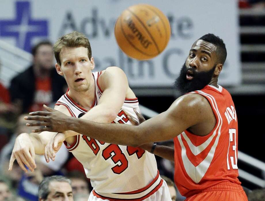 Chicago Bulls guard Mike Dunleavy, left, and Houston Rockets guard James Harden watch the ball after Dunleavy passed it during the first half of an NBA basketball game in Chicago on Thursday, March 13, 2014. (AP Photo/Nam Y. Huh) Photo: Associated Press