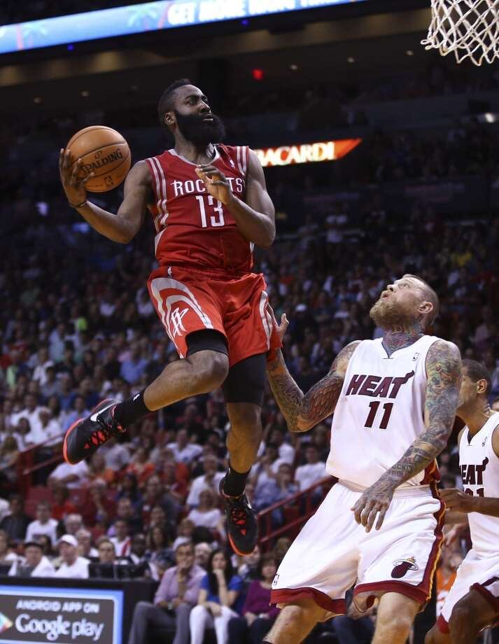 Houston Rockets' James Harden (13) goes over Miami Heat's Chris Andersen (11) for two points during the second half of an NBA  basketball game in Miami, Sunday, March 16, 2014. The Heat won 113-104.  (AP Photo/J Pat Carter) Photo: Associated Press