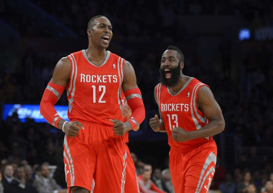 Houston Rockets center Dwight Howard, left, and guard James Harden reacts after Howard was called for a technical foul during the first half of an NBA basketball game against the Los Angeles Lakers, Wednesday, Feb. 19, 2014, in Los Angeles. (AP Photo/Mark J. Terrill) Photo: Associated Press