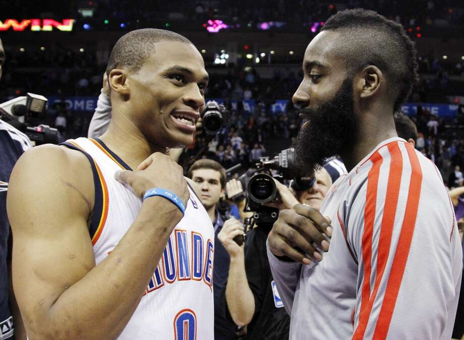 Oklahoma City Thunder guard Russell Westbrook (0) and Houston Rockets guard James Harden, right, talk after their NBA basketball game in Oklahoma City, Wednesday, Nov. 28, 2012. Oklahoma City won 120-98. (AP Photo/Sue Ogrocki) Photo: Associated Press