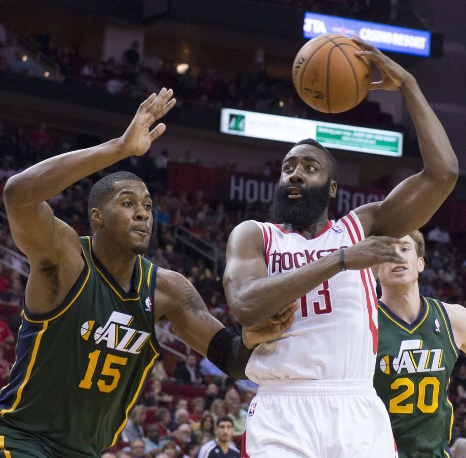 James Harden (13) of the Houston Rockets dumps an over-the-head pass against Derrick Favors (15) of the Utah Jazz in the second half of the Rockets' 124-86 victory on Monday, March 17, 2014, in Houston. (George Bridges/MCT) Photo: McClatchy-Tribune News Service