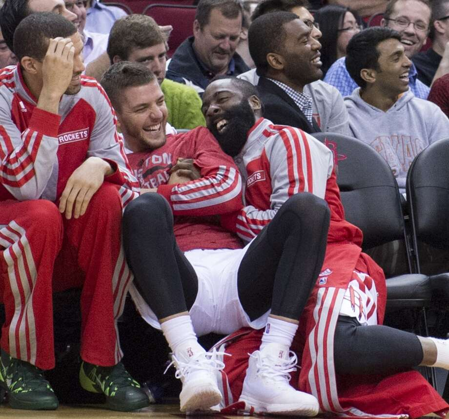 Chandler Parsons (25) and James Harden (13) of the Houston Rockets have fun on the bench in the second half of the Rockets' 124-86 victory over the Utah Jazz on Monday, March 17, 2014, in Houston. (George Bridges/MCT) Photo: McClatchy-Tribune News Service