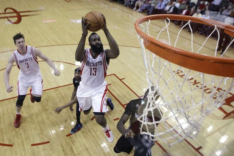 Houston Rockets guard James Harden takes a shot during the first half of an NBA basketball game against the Minnesota Timberwolves, Thursday, March 20, 2014, in Houston. The Rockets defeated the Timberwolves 129-106. (AP Photo/Patric Schneider) Photo: Associated Press