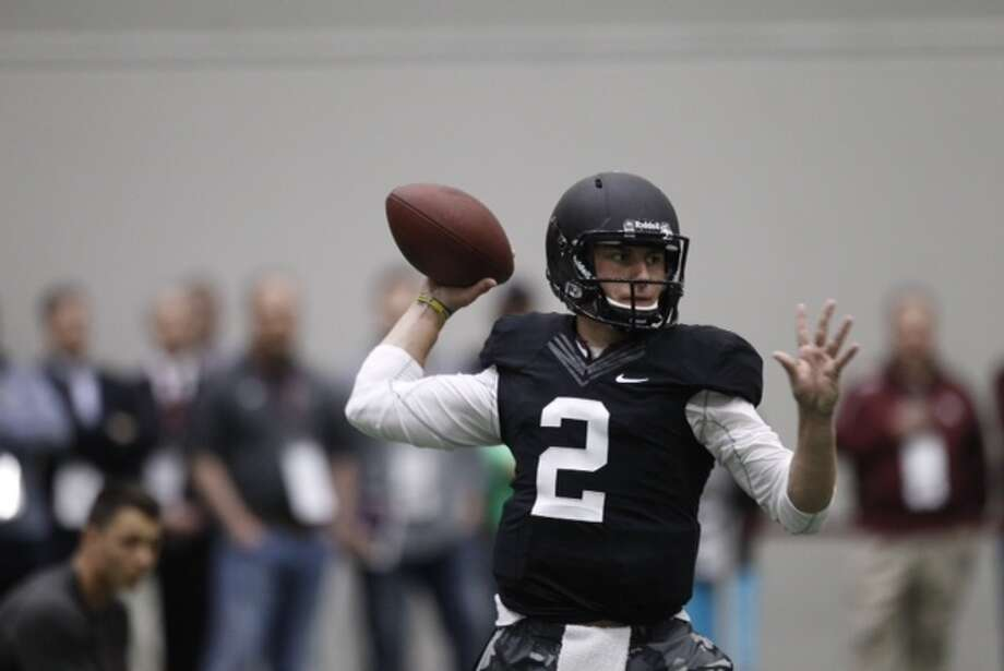 Johnny Manziel throws during his pro day in College Station. Photo: Brett Coomer, Houston Chronicle