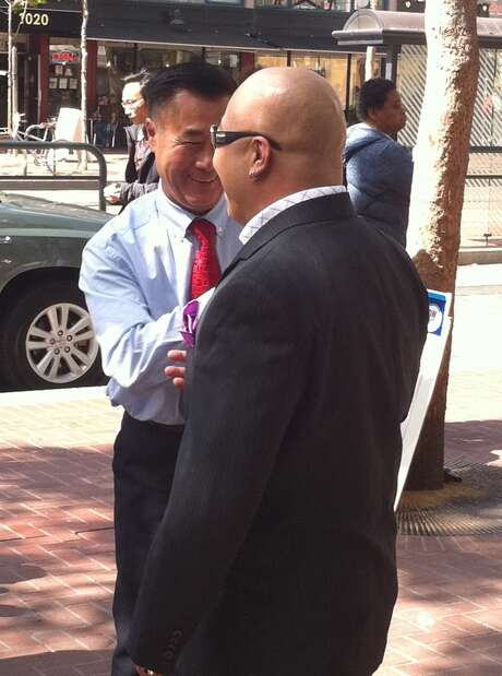 "Leland Yee, left, talks with Raymond ""Shrimp Boy"" Chow during a rally against David Chiu in 2010. Photo: Handout, Courtesy"