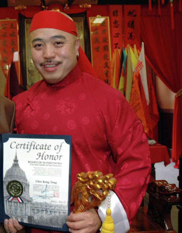 """Raymond """"Shrimp Boy'' Chow, who was indicted on racketeering charges in 1992, shows the certificate that was arranged by city Supervisor Fiona Ma. Photo: Special To The Chronicle, SFC / Chronicle"""